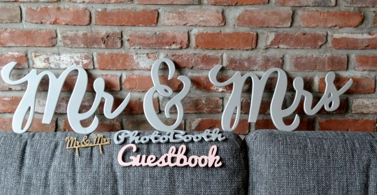 ZCreateDesign offers their handmade table signs in different fonts and colors (including glitter)!